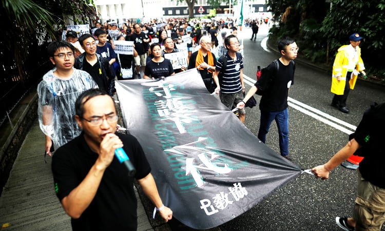 Hong Kong teachers take to the streets to join the protests against the regional Executive