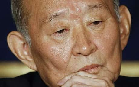 Japanese finance minister says government should announce end of deflation