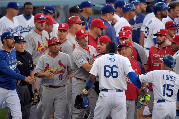 Dodgers hold off Cardinals in opener