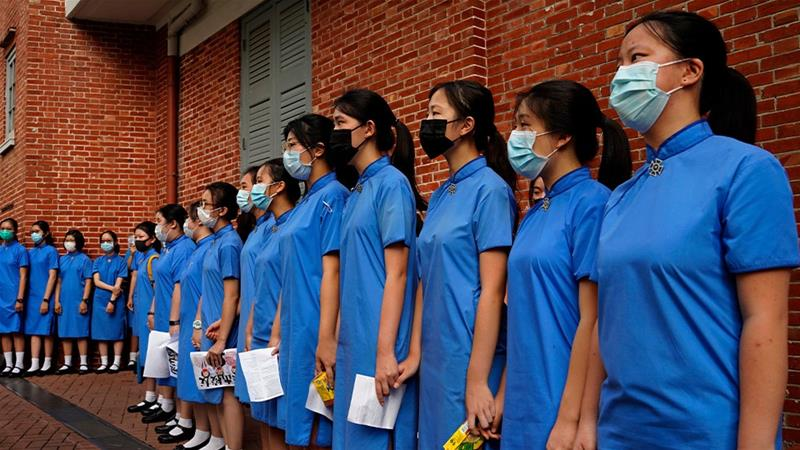 Hong Kong students form a human chain in several districts after another weekend of protests