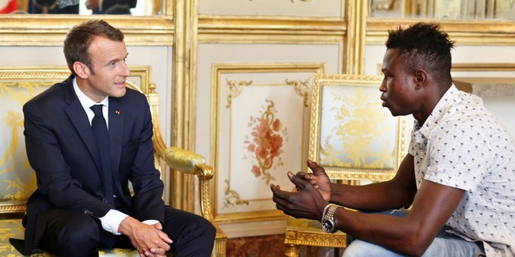 Macron thanks migrant who saved dangling child, asks him to apply for citizenship
