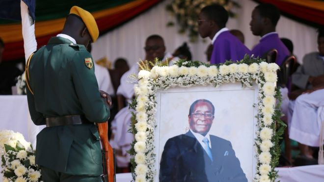 Mugabe's body is finally buried in his hometown of Zimbabwe