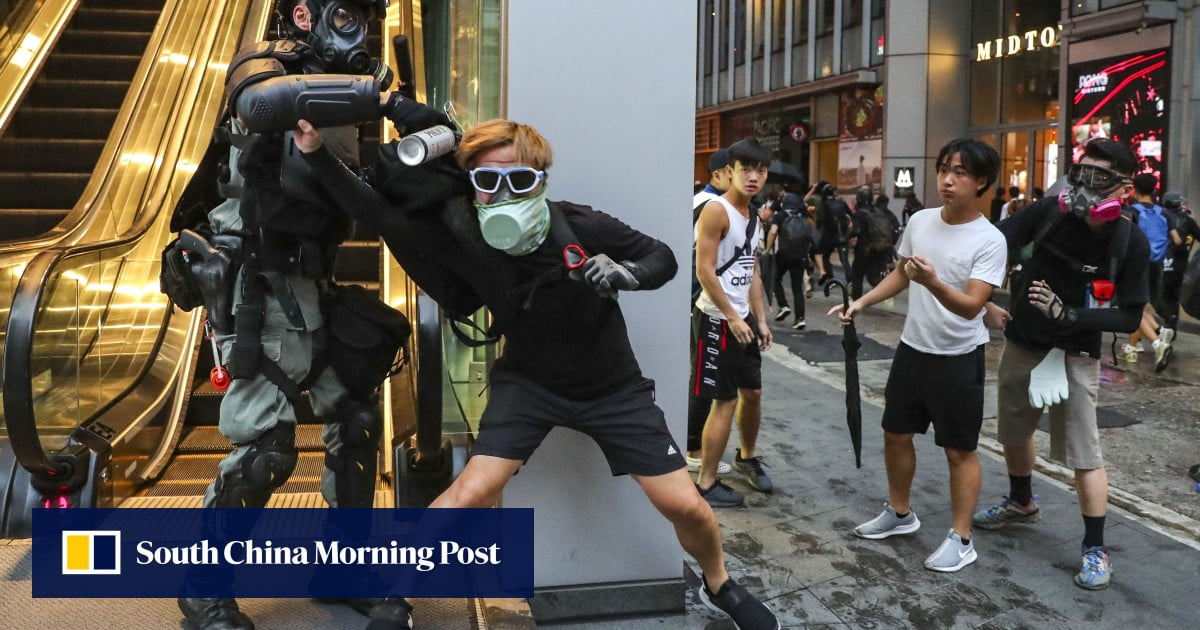 At least 77 detainees in Hong Kong for violating the law that prohibits covering their faces