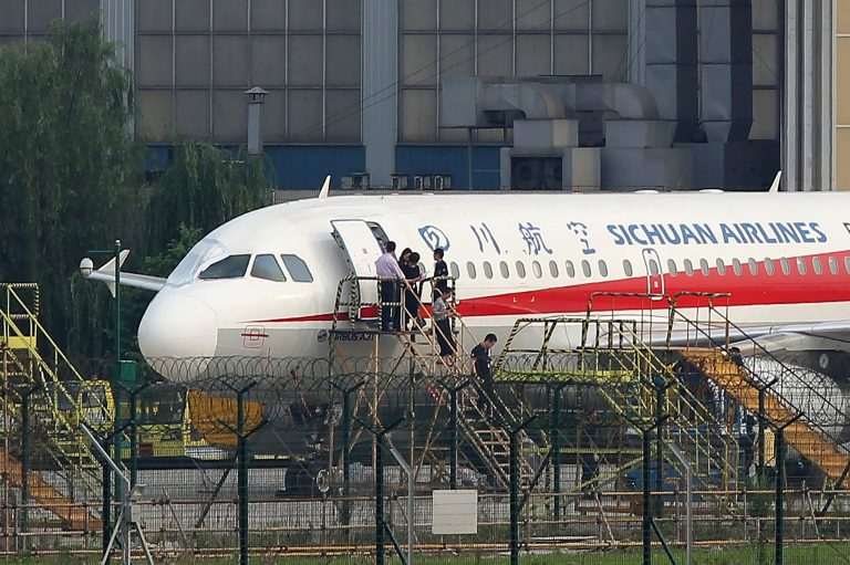 Co-pilot sucked halfway out of windshield during Chinese flight