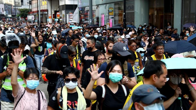 Hong Kong protesters again defy the law that prohibits wearing a face