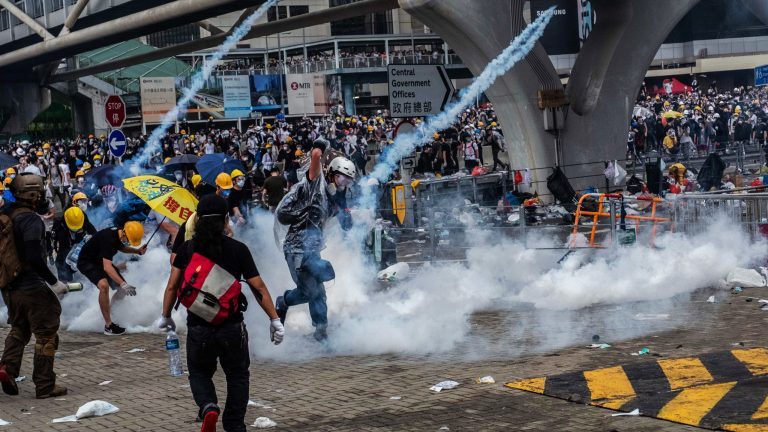 Police charge protesters on a new day of protests in Hong Kong