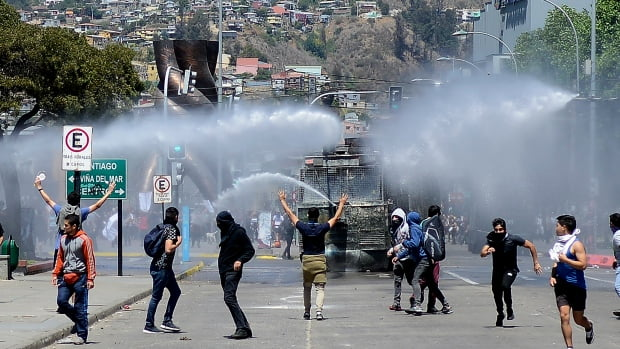 Protesters return to the streets of Santiago on another day of protests against the Government