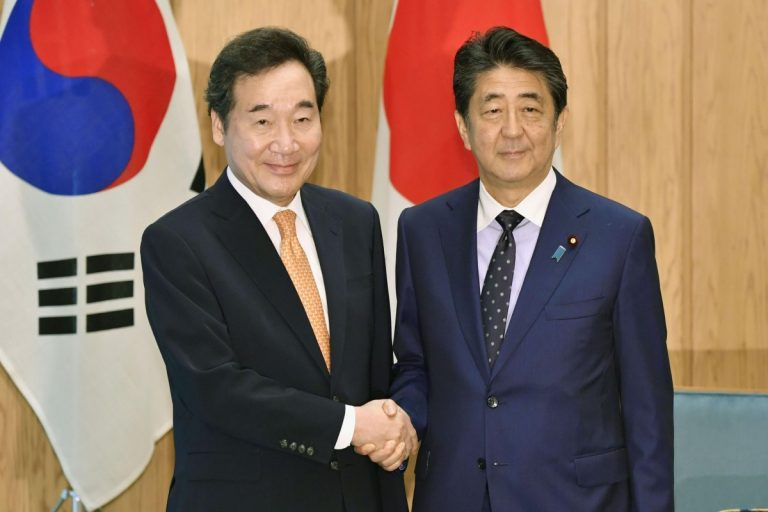 The Prime Minister of Japan meets with his South Korean counterpart to discuss commercial and historical disputes