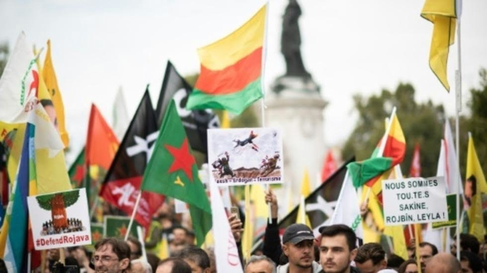 Thousands of people march through Paris and Athens to protest against the Turkish operation in Syria