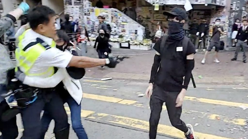 A protester shot in Hong Kong Police on a new day of protests