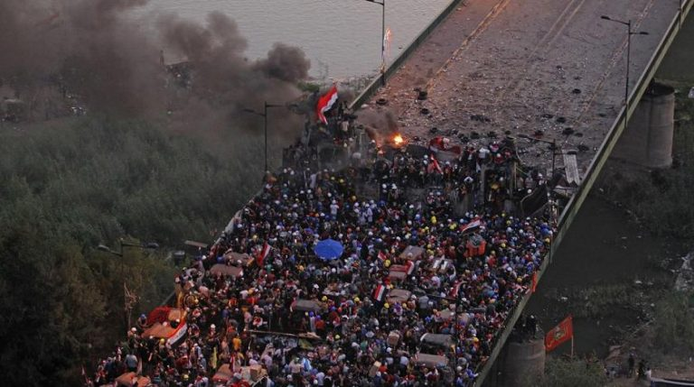 At least four protesters are killed by security forces firing in Baghdad