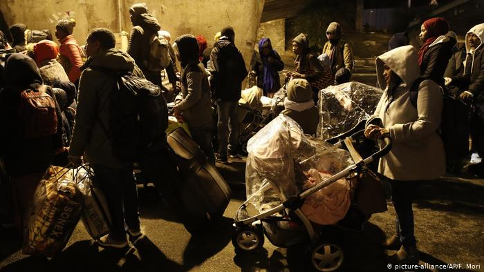 French police evict a migrant camp in northern Paris