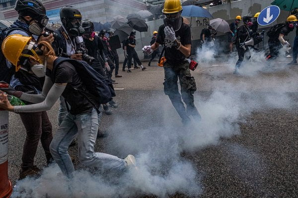 Hong Kong Police again use tear gas to disperse new protests in the territory