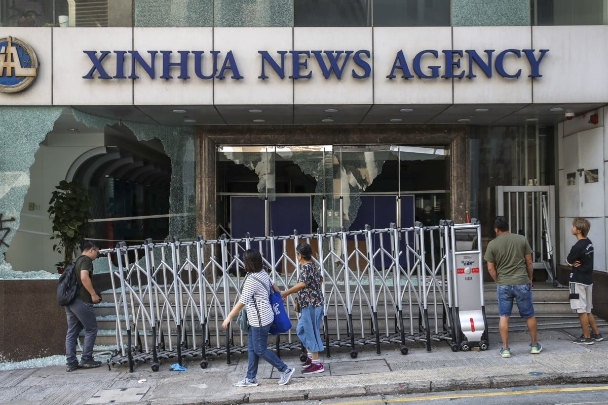 Hong Kong protesters break into the headquarters of the official Chinese news agency