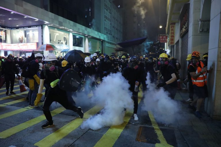 Police launch tear gas to disperse protesters in three different areas of Hong Kong