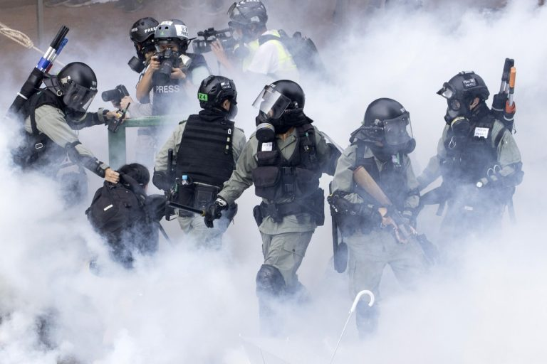 Police maintain siege of the Hong Kong Polytechnic amid riots in support of students