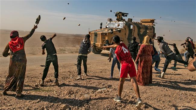 Turkish soldiers open fire in Kobani against protesters against joint patrols with Russia