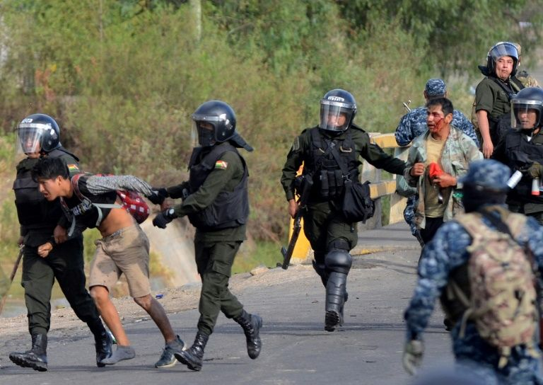 Two killed by gunfire in clashes between Morales fans and opponents in central Bolivia