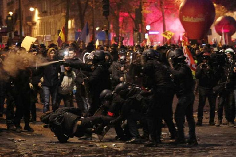 Clashes between police and protesters in Paris during the strike against pension reform