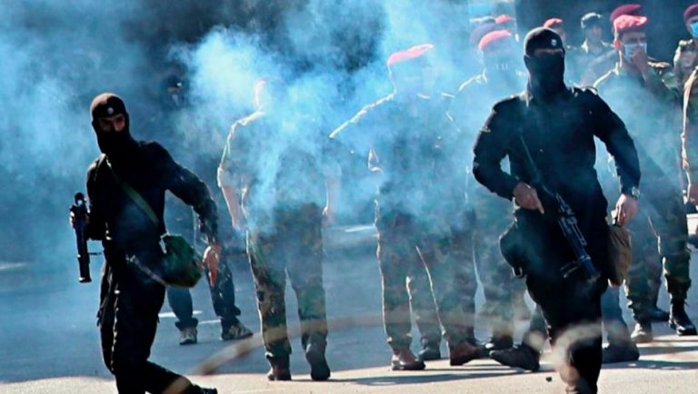 Iraqi Police disperses a new protest in the southern part of the country with tear gas