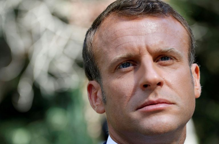 Macron is evacuated from a theater after protesters tried to access the compound