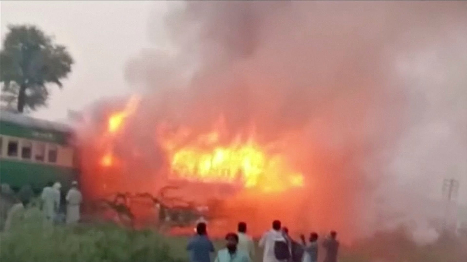 The death toll rises to 65 on a train fire in northern Pakistan