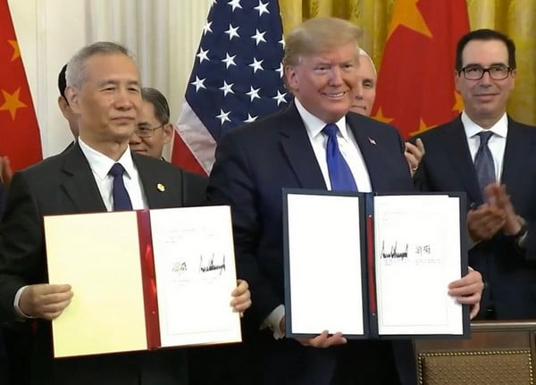 The US signs commercial peace with China and pledges to eliminate tariffs in 'Phase 2' of the agreement