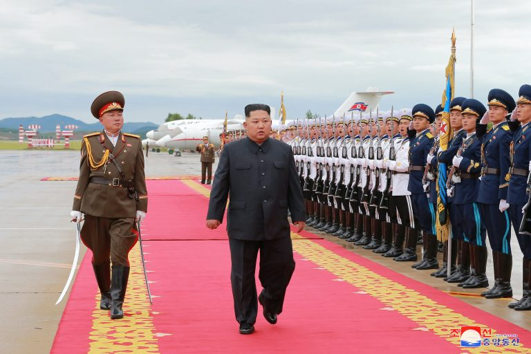 Kim 'would give up nukes if security guaranteed'
