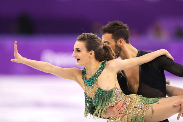 Olympic skater sails through wardrobe malfunction
