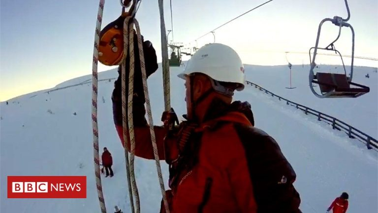 Stranded skiers' chairlift chopper rescue