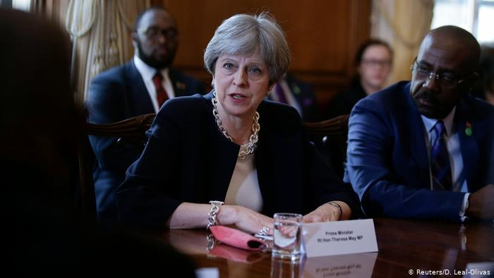 Theresa May Apologizes for Delays in Britain's Health System