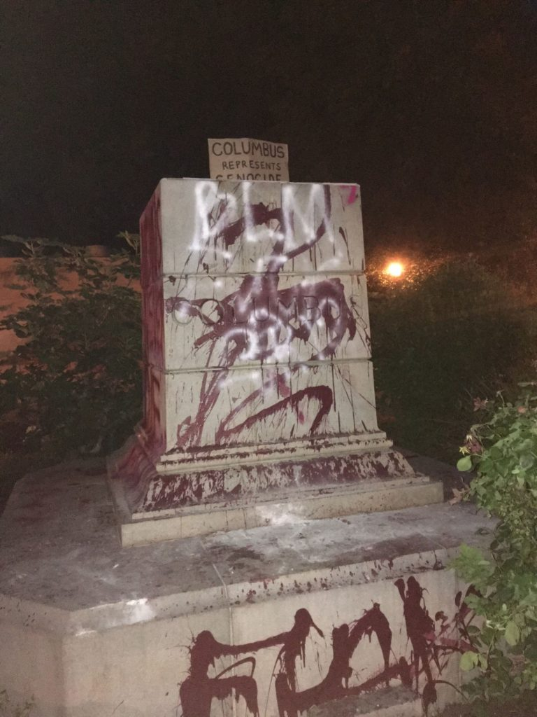 Several protesters destroy, burn and throw a statue of Christopher Columbus in Virginia into a lake