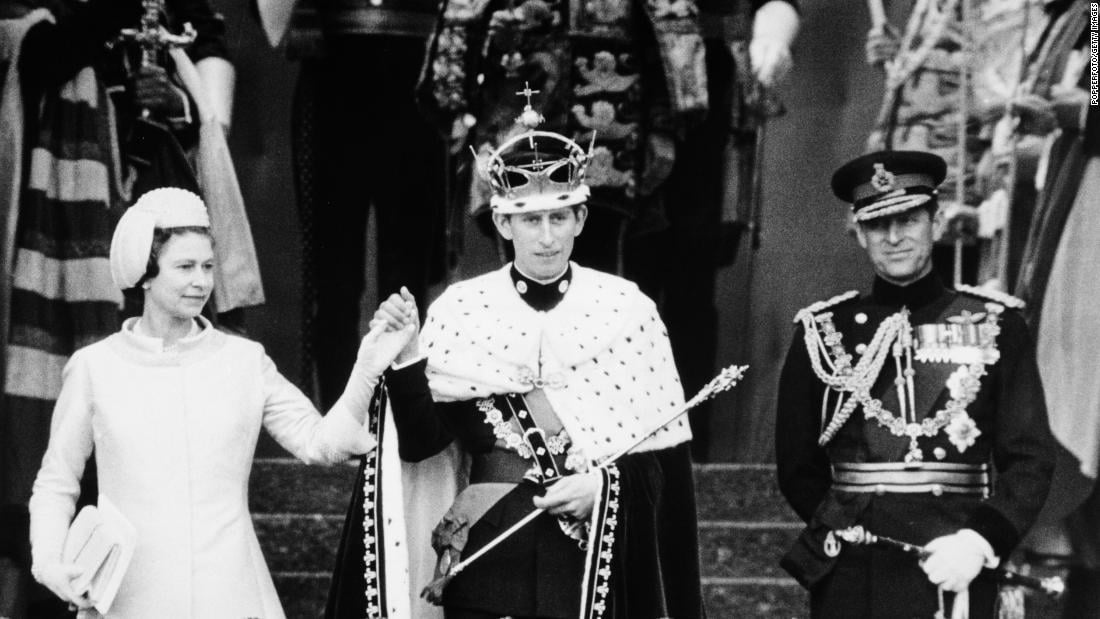 Queen Elizabeth II's husband surrenders his military role to Prince Charles' wife
