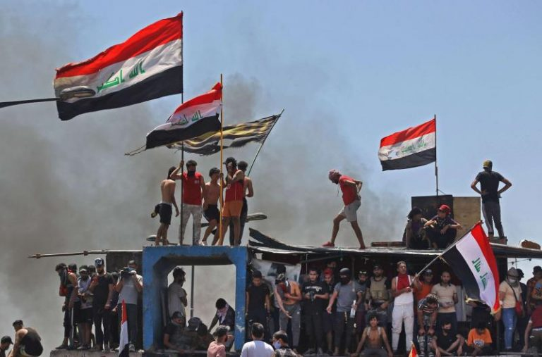 Protesters in Iraq try to set fire to the parliament building in the south of the country