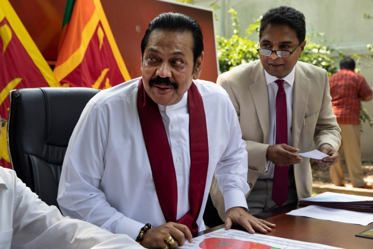 Rajapaksa sets up his new government after winning Sri Lanka's parliamentary elections