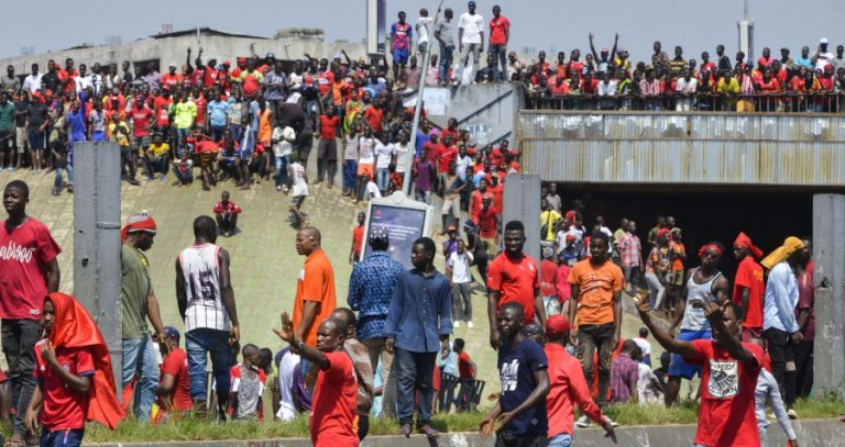 Guinean security forces fire tear gas during protests in Conakry against Condé