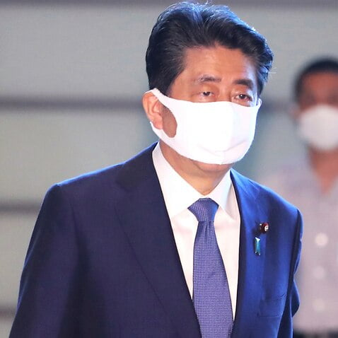 Japan's government resigns en bloc before Abe's successor takes over the post of prime minister