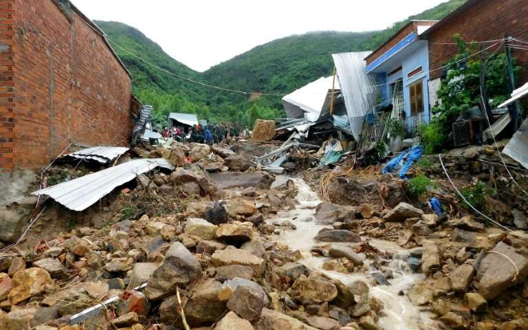At least 18 dead and 14 missing in storms in central Vietnam
