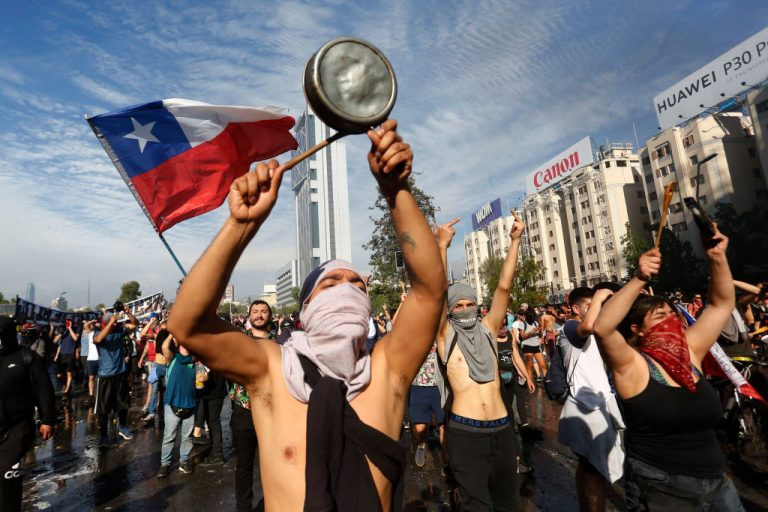Thousands of people celebrate the first anniversary of the start of social protests in Chile
