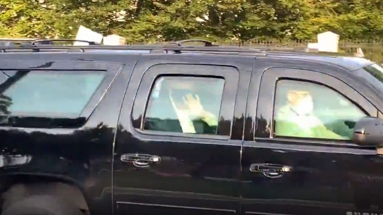 Trump drives through the hospital where he is admitted to greet his supporters