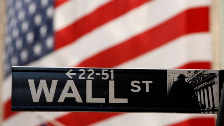 Wall Street surged, closing historical records on the Dow Jones and Nasdaq