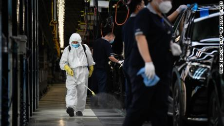 """China claims to be """"ready"""" to work with WHO on COVID-19 investigation"""